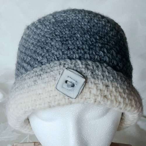 silver gray cloche with button